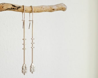 Long tribal silver earrings, a balance between lines and balls