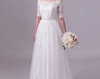 Off shoulder lace wedding dress in ivory color, alencon lace with tulle skirt.