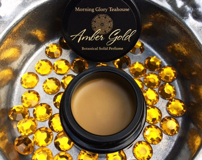 Amber Gold Botanical Solid Perfume ~ smoky, dry-wood amber and precious spicy resins delicately blended with earth, sweetness & gold dust