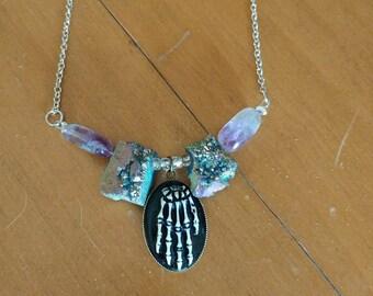Skeletal hand pendant with druzy stones necklace