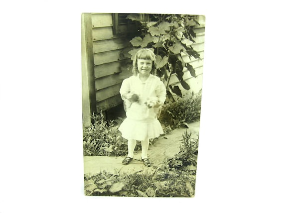 Antique Real Photo Postcard of a Little Girl with Wiggling Kittens AZO Back Stamp RPP