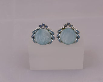 Stunning Vintage Motif Silver Toned Blue Mother of Pearl, Enamel and Blue Rhinestone Clip ons! Perfect compliment to any vintage outfit!