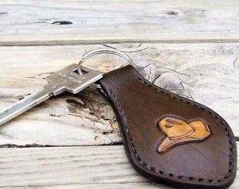 Key fob, dark brown leather western, cowboy hat in clear, sewn in saddle stitch
