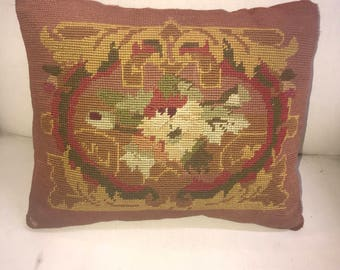 Antique needle point pillow. Insert is down and feathers. one single pillow
