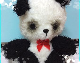 Crochet panda bear plush