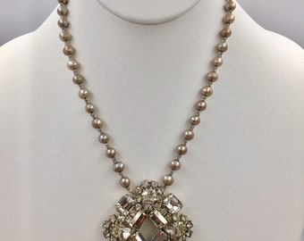 Star Bright is a one-of-a-kind, statement necklace made from a vintage, prong-set clear rhinestone brooch on freshwater pearls