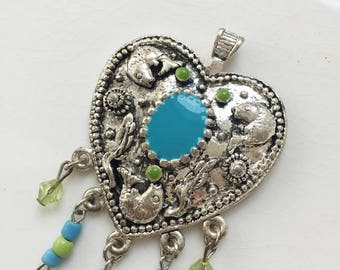 large new stock silver tone metal heart pendant with fish design, enameled center, and beaded tassles