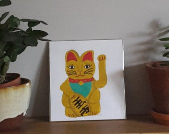 Oriental lucky cat ornament painting, acrylic on paper. Quirky character, folk, naive art.
