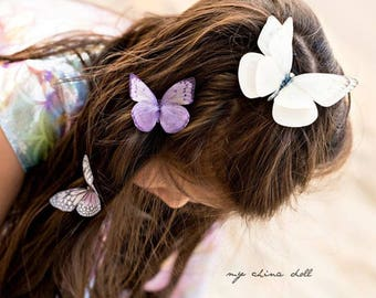 Brides Soft Cream silk butterfly hair clip with Crystal detail. Perfect for weddings!
