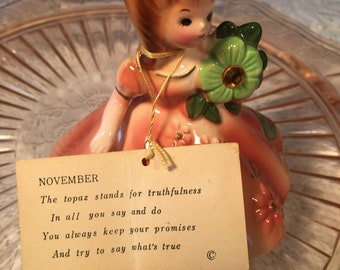 Josef figurine November girl topaz signed with sticker and hang tag