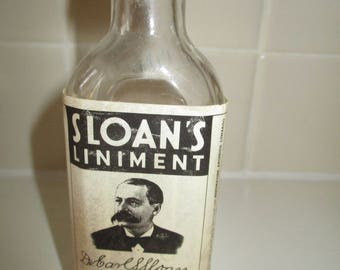 Vintage Sloan's Liniment - bottle 2/3rds full advertising collectable piece.  Dr. Carl S. Sloan original piece.  Made in USA