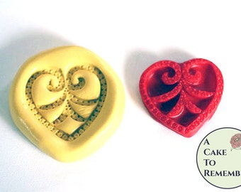 Jeweled heart mold for cake decorating, soap embeds, cupcake decorating and cake pops. Also good for polymer clay , utee, or resin mold