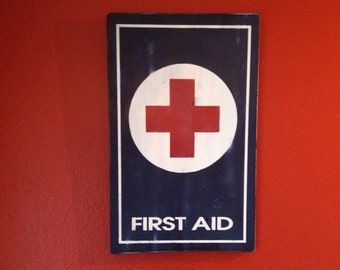 First aid hand painted wooden sign.