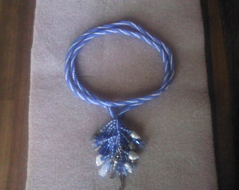 beach comber,  a 24 in. necklace worked in blue and pale blue glass seed, beads using a spiral herring bone stitch.
