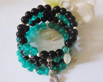 Multi row bracelet in Emerald and black glass beads