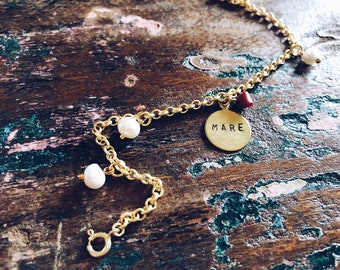 Brass bracelets with beads, corals and engraved pendant