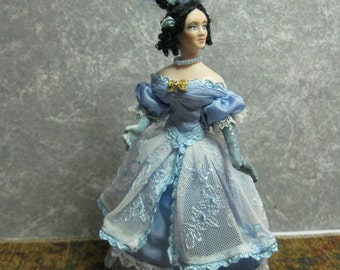 Miniature Porcelain 1/12 scale doll  A fashion conscious lady of the 1830's with elaborate hairstyle