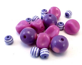 Assortment of pink and purple plastic beads