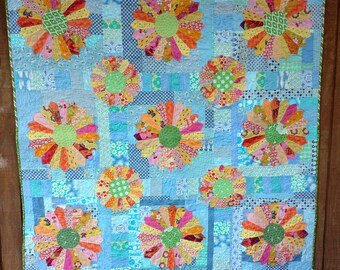 Scrappy Dresden- two sizes of Dresden plates on a pieced background quilt pattern