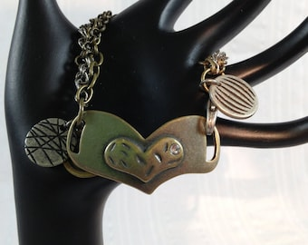 Bracelet with heart shaped charm and chains