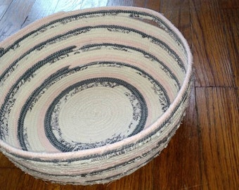 Pink, cream, and charcoal grey basket