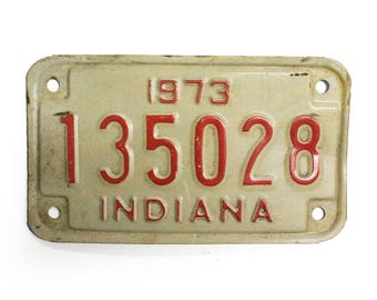 1973 Indiana Motorcycle License Plate - White And Red Vintage Used Bike License Plate (77-BO-LP-0084)