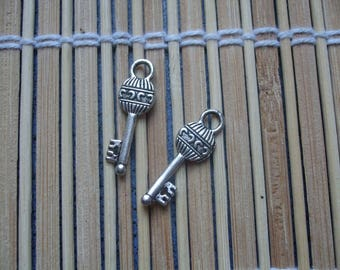 2 silver metal key fobs