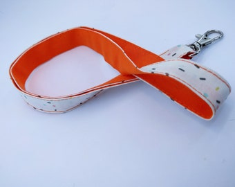 Cord key chain, orange and multicolor sprinkles