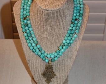 Dark Turquoise Beaded Necklace with Ethiopian Cross Pendant