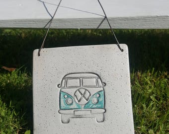 Wall-hanging clay tile,featuring blue VW camper,beach/coastal theme.