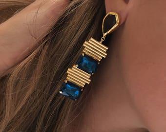 Blue stone cutting edge gold drop earrings