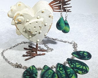 Necklace and earring set. Handcrafted green and dark blue black Polymer Clay. Graduated teardrops with silver beads and chain.