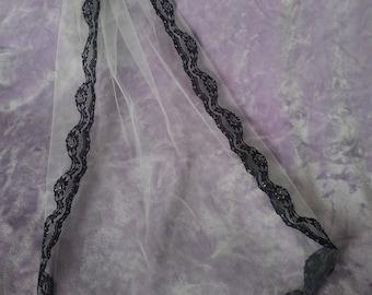 Handsewn black lace trim veil