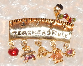 SALE....Novelty Teacher's Pin / Brooch with Charms '' Teacher's Rule '' with Apple, Boy .Bell,Boy, and Heart Charms