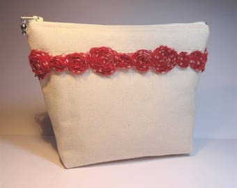 Ecru bag lined with red flowers with white polka dots