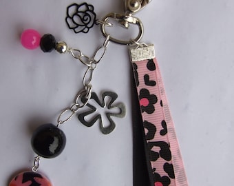 Pink and black charm