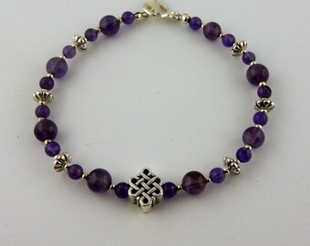 Genuine Amethyst gemstone bracelet with a Silver Celtic Knot focal bead