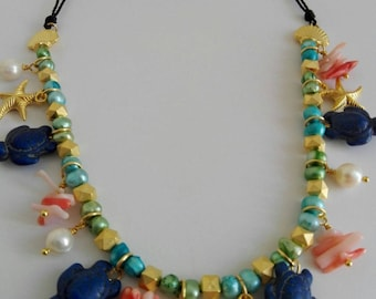 Short Necklace of pearls, coral and Turquesina.