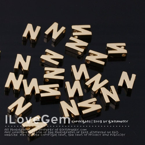 letters in alphabet np 1458 matt gold plated mini pendant alphabet letter n 1458