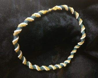 Handcrafted green gold twisted beaded necklace with magnetic clasp