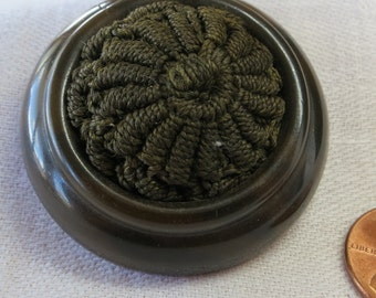 "Vintage button, 1.5""inches across, tight top over metal base.  Wool center, raised rim, dark brown. Unusual, nice condition. HM15.1-25.7."