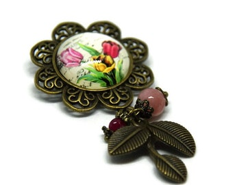 Floral brooch, her pink pearls, fuchsia and foliage