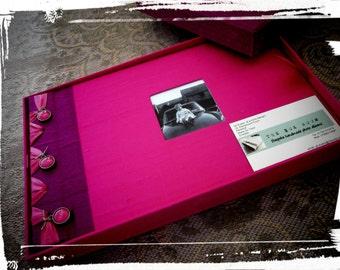 Boxed handmade photo album.