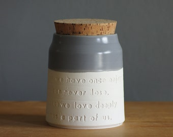customized urn for human or pet cremains. quote option shown. Modern simple pottery. shown in porcelain and dark grey. handmade memorial urn
