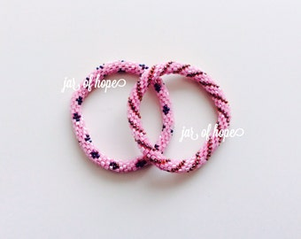 Nepal Beaded Roll On Bracelets Set of 2 Gift Birthday  Pink Plum Brown Spiral