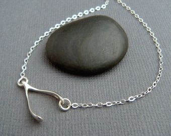 sideways wishbone necklace. lucky charm necklace. small silver wishbone. horizontal. good luck. sterling. delicate. simple everyday jewelry.