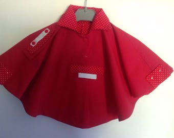Small red cape lined with white polka dots