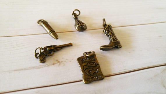 Western charms antiqued bronze outlaw charms set bronze like this item aloadofball Image collections