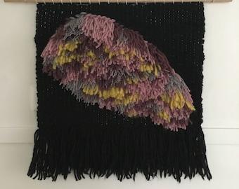 Tasseled weave, woollen wall hanging