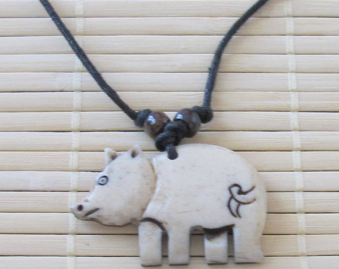 Carved pig - ox bone  pendant - PB019